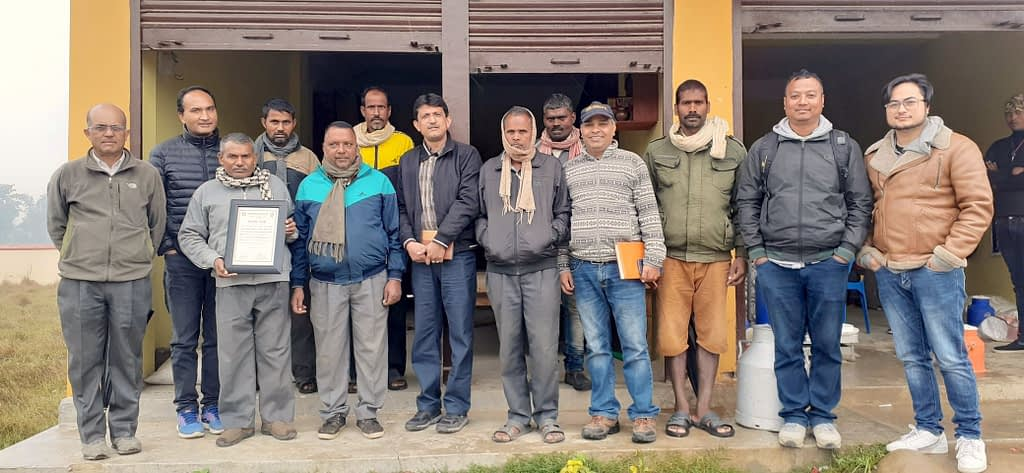 Dyutiman Choudhary (seventh from left) with seed producers during a field visit. (Photo: Dipak Kafle)