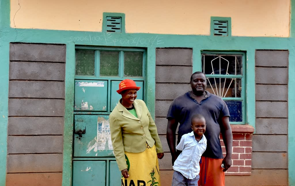 Ruth Kanini Somba (left) stands for a portrait with her husband Alex and their 8-year-old son. (Photo: Jerome Bossuet/CIMMYT)