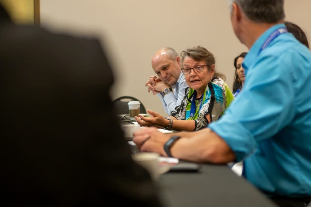 Linda McCandless (center) of Cornell University and David Hodson (left) of CIMMYT were among the panelists sharing tips on wheat news coverage at the journalist roundtable. (Photo: Matt Hayes/Cornell)