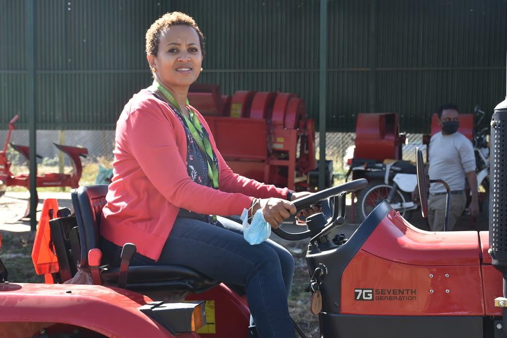 Rahel Assefa tests out farm machinery in Addis Ababa, Ethiopia. (Photo: Simret Yasabu/CIMMYT)