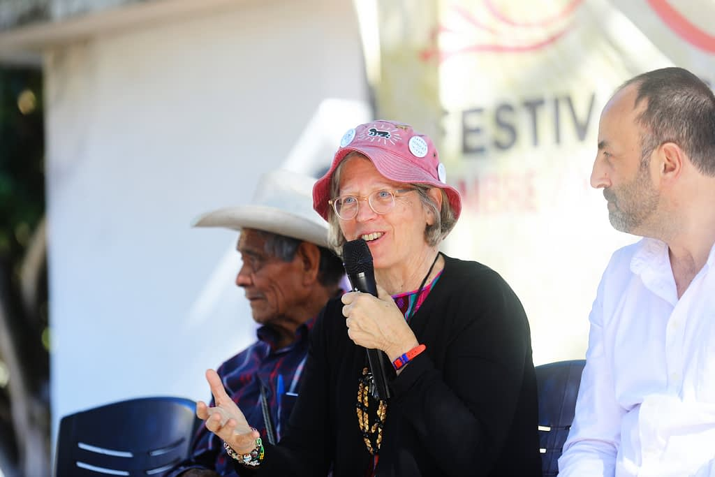Costich (center) shares some comments from the stage at the Second Harvest Fair and Largest Mature Ear of Jala Maize Contest in Coapa, in Mexico's Nayarit state. To her left is Angel Perez, a participating farmer from La Cofradía, and to her right, Rafael Mier, Director of the Fundación Tortillas de Maíz Mexicana.