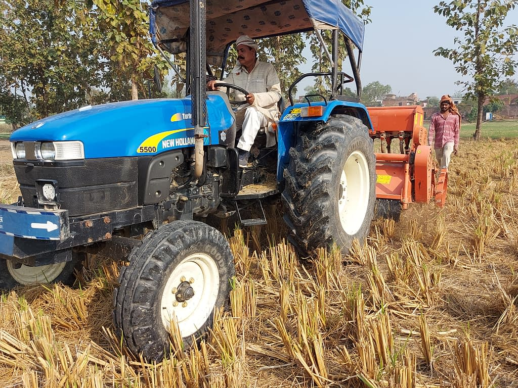 Surender Prasad drives his Happy Seeder-mounted tractor in Uttar Pradesh, India. (Photo: Nima Chodon/CIMMYT)