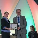 Hans-Joachim Braun (center) receives the Crop Science Society of America Fellow certificate onstage. (Photo: Johanna Franziska Braun/CIMMYT)