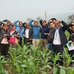 Training participants imitate the fall armyworm's white inverted Y mark visible on the front of the head of the larva. (Photo: Bandana Pradhan/CIMMYT)