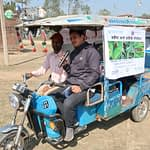 Outreach workers use an auto-rickshaw equipped with a sound system and infographics to disseminate information about armyworm in Nepal's Banke district. (Photo: Darbin Joshi/CIMMYT.)