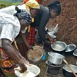 Cooks prepare ugali, or maize flour porridge, with different maize varieties at a sensory evaluation in Kakamega County, Kenya. (Photo: Joshua Masinde/CIMMYT)