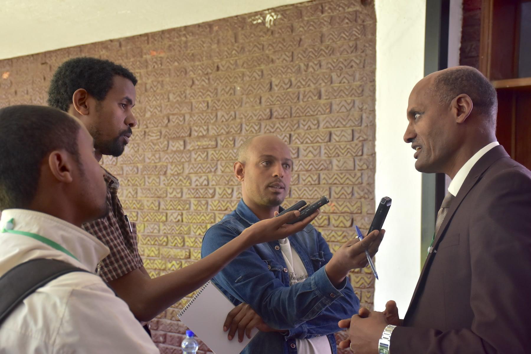 CIMMYT's representative in Ethiopia, Bekele Abeyo, gives an interview for Ethiopian media. (Photo: Jérôme Bossuet/CIMMYT)