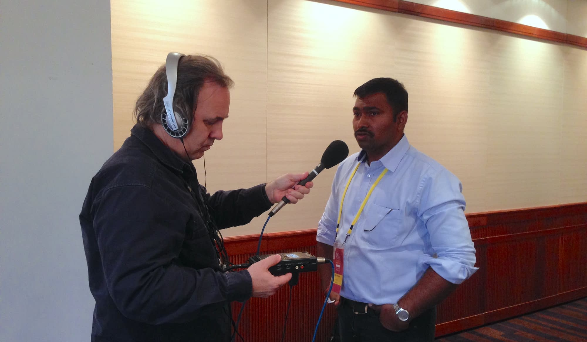 CIMMYT scientist Velu Govindan (right) is interviewed by Michael Condon of ABC Rural at the International Wheat Conference in Sydney, Australia, 2015. (Photo: Julie Mollins/CIMMYT)
