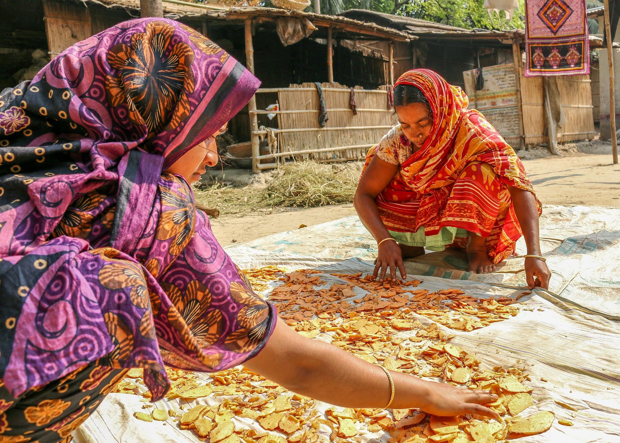 Two women sort orange-fleshed sweet potato in Faridpur district, Bangladesh. (Photo: Sara Quinn/CIP)