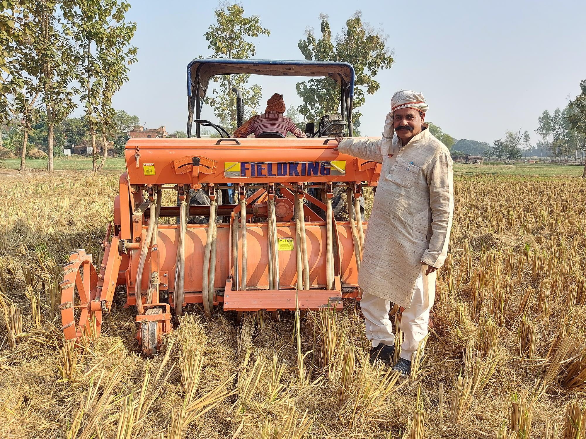 Surender Prasad stands next to his Happy Seeder-mounted tractor in Uttar Pradesh, India. (Photo: Nima Chodon/CIMMYT)