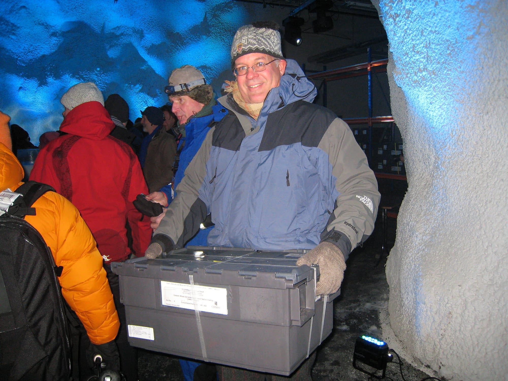 Tom Payne at the Global Seed Vault in Svalbard, Norway, for the official opening ceremony in 2008. He holds one of the sealed boxes used to store the nearly 50,000 unique maize and wheat seed collections deposited by CIMMYT. (Photo: Thomas Lumpkin/CIMMYT)