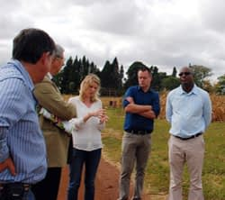 Seed systems specialist Peter Setimela explains the importance of regional on-farm trials to the Swiss Ambassador Luciano Lavizzari (middle) and SDC Food Security program officer for Zimbabwe Mkhululi Ngwenya.