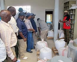 Paddy Likhayo, an entomologist with KARI, explains to the delegation the on-station demonstration trials at the Nakuru Agricultural Technology Development Center. Photo: Wandera Ojanji/CIMMYT
