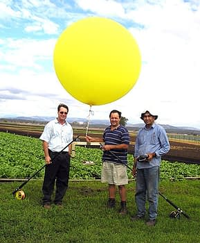 The way it was in 2007. Troy Jensen and Amjed Hussain of the University of Southern Queensland, utilizing a helium-filled balloon for aerial imagery of a cabbage research trial in SE Queensland. Photo: Troy Jensen