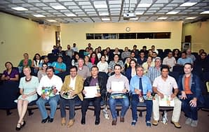 GCAP International Training Course on Conservation Agriculture (CA) graduates hold certificates, which authorize them to teach and train others on CA practices, during the Course's closing ceremony. Photo: CIMMYT