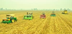 """uper SMS fitted combine harvester and Happy Seeder"""" for simultaneously harvesting of rice and seeding of wheat. Photo: HS Sidhu /CIMMYT"""