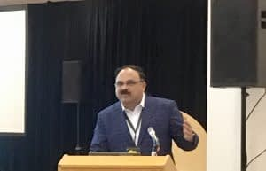 Scientist B.M. Prasanna, director of the Global Maize Program at CIMMYT and the CGIAR Research Program on Maize, speaks at a Borlaug Dialogue side event about the fall armyworm with a panel of scientific experts. CIMMYT/Julie Mollins