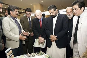 Mr. Sikandar Hayat Bosan (left), Federal Minister of Food Security & Research, and Mr. Gregory Gottlieb (red tie), Director for USAID Pakistan, visited the stand and talked to Imtiaz Muhammad (far right), CIMMYT Country Representative in Pakistan, and AIP component leads about their programs.Photos: Amina Nasim Khan