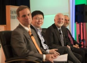"""Speakers on panel """"How Can CRISPR-Cas Technology Assist Small Holder Farmers Around the World?"""" at the 2017 Borlaug Dialogue in Des Moines Iowa. L-R: Kevin Pixley, leader of the Seeds of Discovery project and the Genetic Resources Program at CIMMYT; Feng Zhang, core member of Broad Institute; Neal Gutterson, a member of CIMMYT's board of trustees and vice president of research and development at DuPont Pioneer, part of the agriculture division at DowDuPont; Nigel Taylor, interim director of the Institute for International Crop Improvement at Donald Danforth Plant Science Center. Picture credit: World Food Prize"""