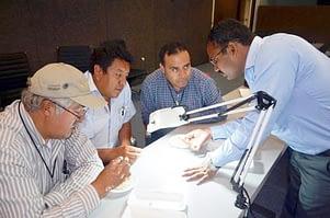 Dr. Vijay Chaikam shows the group how to identify haploid seeds. Photo: CIMMYT