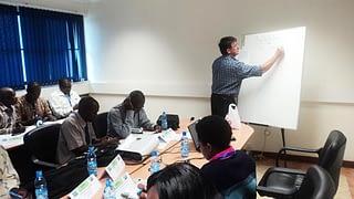 CIMMYT seed sytems lead John MacRobert facilitates a SEMIs seed production class at the College of Agriculture and Veterinary Sciences at the University of Nairobi. Photo: David Ndung'u/SEMIs