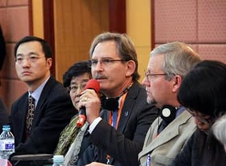 Dan Jeffers (second from the left) attends a meeting in the Great Hall of China. Source: CCTV13