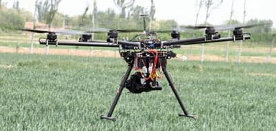 The DJI Spreading Wings S900 Hexo-copter fitted with an MKII Canon SLR Visual Camera flying over winter wheat near Wuzhong City, China. Photo: Jack McHugh/CIMMYT