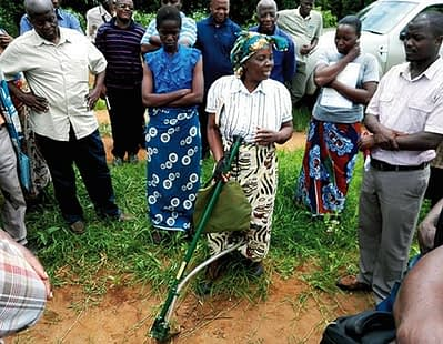 Transforming agriculture through technology: Mrs Grace Chitanje,one of the farmers in Mitundu District, Malawi, demonstrates how to use the Li seeder.