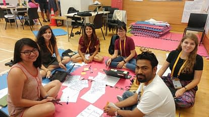 Jennifer Johnson (first from right) and her team at UNLEASH 2018 work on solutions to improve nutrition for adolescent girls in Nepal. (Photo: Jennifer Johnson)