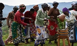 Actors celebrating a fruitful harvest thanks to drought-tolerant maize. Photo: Brenda Wawa/CIMMYT
