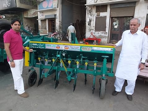 Father and son Iqbal Mughal and Irfan Mughal are co-owners of Greenland Engineering, which currently manufactures zero-tillage wheat drills for Pakistan's farming communities. They worked with CIMMYT from 1994-2003 as part of the the rice-wheat consortium. In response to the interest expressed by farmers, they are also producing the new multicrop planter for rice farmers in Daska, Punjab Province. Photo: Mumtaz Ahmed/Engro Fertilizers