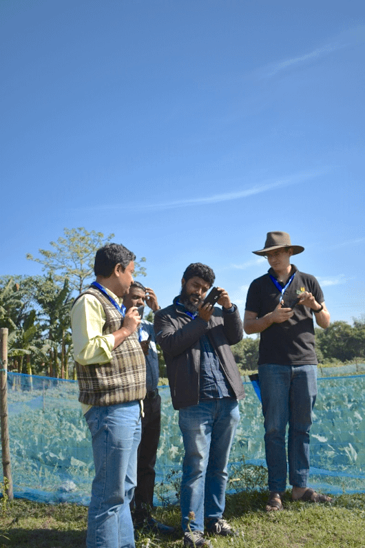 Field technicians use their cameras during the Photovoice training. (Photo: CIMMYT)