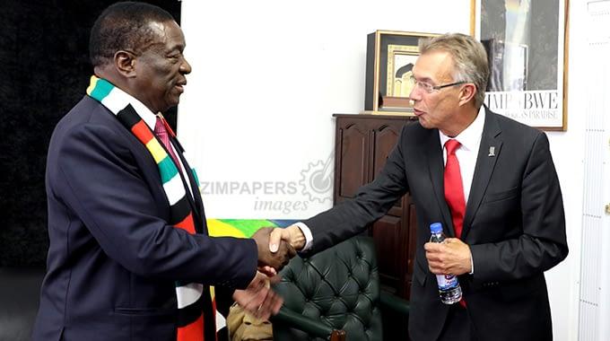 CIMMYT's director general Martin Kropff (right) greets the president of Zimbabwe, Emmerson Mnangagwa, at Munhumutapa Offices in Harare. (Picture by Tawanda Mudimu)