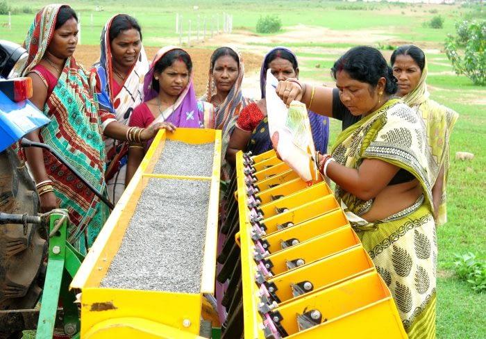 Women are adopting mechanization and using seed drills. Photo: CIMMYT/ Wasim Iftikar