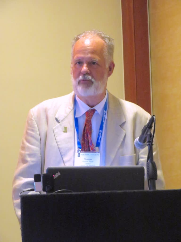 Thomas Payne delivers a presentation at the Crop Science Society of America's annual Genetic Resources breakfast, where he received the award. (Photo: Kevin Pixley/CIMMYT)