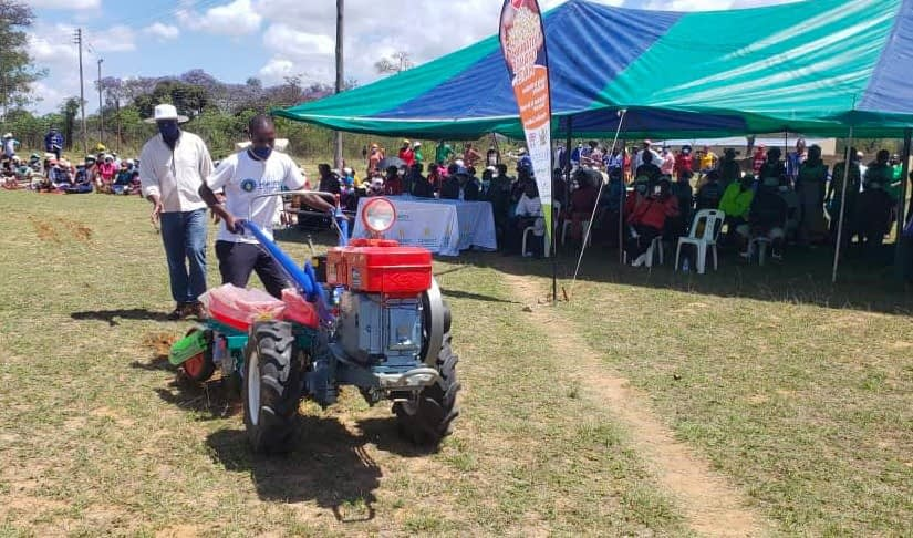 Representatives from Kurima machinery conduct a demonstration of the two-wheel tractor during the seed fair in Masvingo, Zimbabwe. (Photo: Shiela Chikulo/CIMMYT)