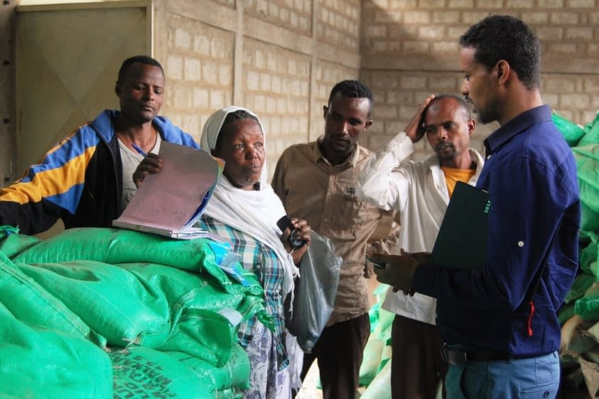 In Zewai Dugda, storekeeper Embete Habesha discusses her store records with Tadele Asfaw, CIMMYT-Ethiopia program management officer and member of the Seed Procurement Committee for the emergency seed project funded by USAID. Photo: E.Quilligan/CIMMYT