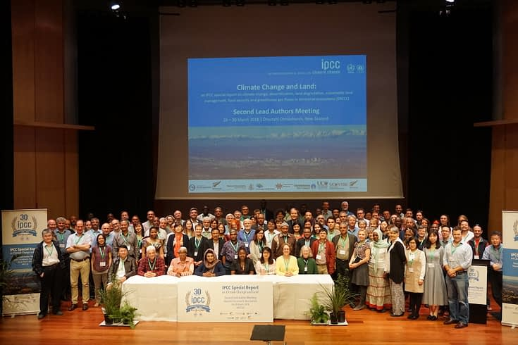 Tek Sapkota (center) stands for a group photo with other scientists working on the IPCC's special report on climate change and land, at the second lead author meeting in Christchurch, New Zealand, in March 2018.