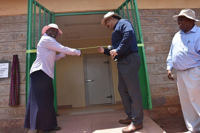 The director of KALRO's Food Crops Research Institute, Joyce Malinga (left), the director of CIMMYT Global Maize Program, B.M. Prasanna (center), and CIMMYT's Regional Representative, Stephen Mugo, open the maize seed cold room in Kiboko (Photo: Joshua Masinde/CIMMYT)