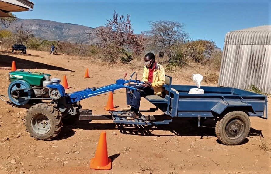 Zvikomborero Karimudengu skillfully operates a two-wheel tractor and trailer during a training session in Nyanga South district, Zimbabwe. Small scale mechanization services are proving to be immensely useful during the COVID-19 pandemic as services can be provided while adhering to social distancing regulations and without requiring additional labour. (Photo: Dorcas Matangi/CIMMYT)